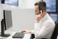 Male call centre operator doing his job Royalty Free Stock Photo