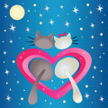 Male cat and pussycat in the heart shape on the blue background Royalty Free Stock Images