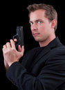 Male caucasian model with a gun Royalty Free Stock Photos