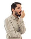 Male checking his breath with the hand. Bad breath. Halitosis co Royalty Free Stock Photo