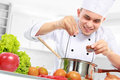 Male chef cooking Royalty Free Stock Image