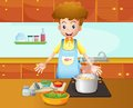 A male chef cooking in the kitchen illustration of Royalty Free Stock Photo