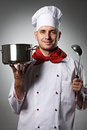 Male chef portrait against grey background Royalty Free Stock Photo