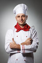 Male chef with thumb up portrait against grey background Royalty Free Stock Photography