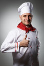Male chef with thumb up portrait against grey background Royalty Free Stock Image
