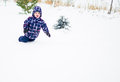 Male Child Playing in Winter Snow Stock Photo