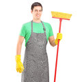 Male cleaner holding a brush Royalty Free Stock Photos