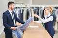Male client takes a woman laundry worker clean clothes women at the dry cleaners Stock Photo