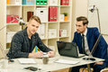 Male colleagues businessmen discussing working issues at the office Royalty Free Stock Photos