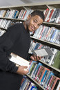 Male College Student At Library Royalty Free Stock Photo