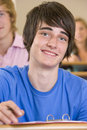 Male college student in a university lecture hall Royalty Free Stock Photography