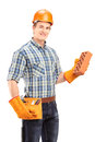 Male construction worker with helmet holding a brick isolated on white background Royalty Free Stock Photo
