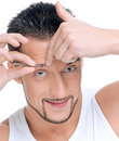 Male cosmetic. Tweezer eyebrow. Stock Images