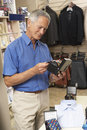Male customer in clothing store Royalty Free Stock Photo