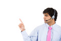 Male customer service representative or call centre worker or operator or support staff pointing closeup portrait of speaking with Stock Photo