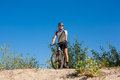 Male cyclist riding bike stopped rolling sand clear summer day Royalty Free Stock Photography