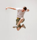 Male dancer jumping in the air picture of Stock Photos