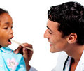 Male doctor checking little girl's throat Stock Photography