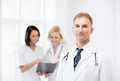 Male doctor with colleagues healthcare and medical concept young in hospital Stock Image