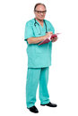 Male doctor in duty hours writing prescription Royalty Free Stock Image