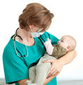 Male doctor examining baby boy Royalty Free Stock Photo