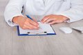 Male doctor filling form close up of s hand forms Royalty Free Stock Photography