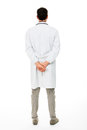 Male doctor with hands behind his back Royalty Free Stock Photo