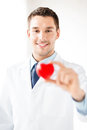 Male doctor with heart bright picture of Stock Image
