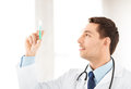 Male doctor holding syringe with injection close up of Stock Photography