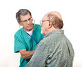Male Doctor LIstens to Senior's Heart Stock Images
