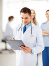 Male doctor writing prescription Royalty Free Stock Photography