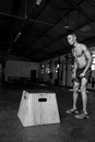 Male doing a box jump in a gym Royalty Free Stock Photo