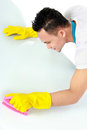 Male doing cleaning Royalty Free Stock Images