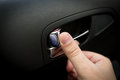 Male driver pressing button locking doors in car Royalty Free Stock Photo