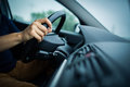 Male driver's hands driving a car on a highway Royalty Free Stock Photo