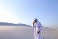 Male Emirati designer completes site survey for construction sit