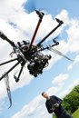 Male engineer flying uav helicopter low angle view of with remote control in park Royalty Free Stock Images