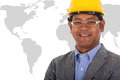 Male engineer wear yellow helmet with world map a Stock Images