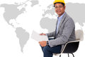 Male engineer wear yellow helmet with world map a Stock Image
