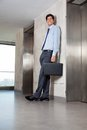 Male entrepreneur standing near lift full length of handsome the Royalty Free Stock Image
