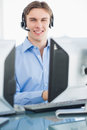 Male executive with headset using computer at desk Royalty Free Stock Photo