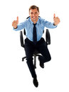 Male executive showing double thumbs up Royalty Free Stock Image