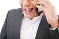 Male executive yelling on his mobile phone Stock Image