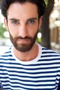 Male fashion model with beard and striped shirt Royalty Free Stock Photo