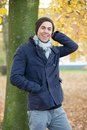 Male fashion model laughing outdoors