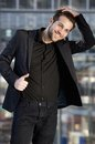 Male fashion model smiling with hand in hair portrait of a Royalty Free Stock Photo
