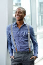 Male fashion model with suspenders smiling Royalty Free Stock Photo