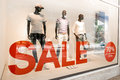 Male fashion sale shopping window outside a men s store Royalty Free Stock Photography