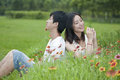 Male and female couple sitting in the flowers Royalty Free Stock Photo