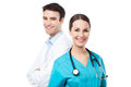 Male and female doctors young couple over white background Royalty Free Stock Images
